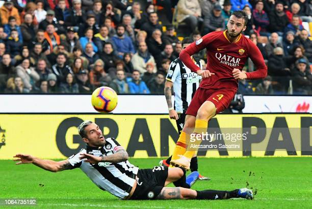 Bryan Cristante of AS Roma competes for the ball with Valon Behrami of Udinese Calcio during the Serie A match between Udinese and AS Roma at Stadio...