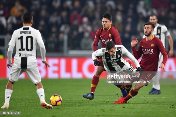 Bryan Cristante of AS Roma fouls on Rodrigo Bentancur of Juventus during the Serie A match between Juventus and AS Roma on December 22 2018 in Turin...