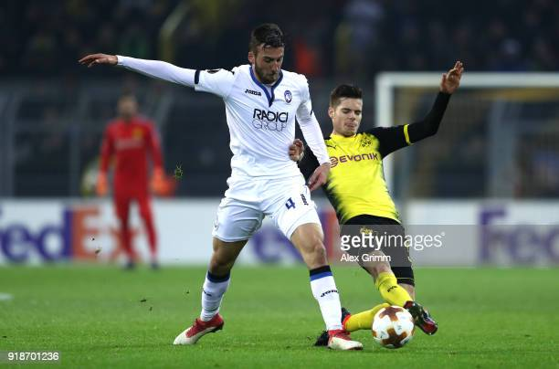 Bryan Cristante of Atalanta and Julian Weigl of Borussia Dortmund in action during UEFA Europa League Round of 32 match between Borussia Dortmund and...