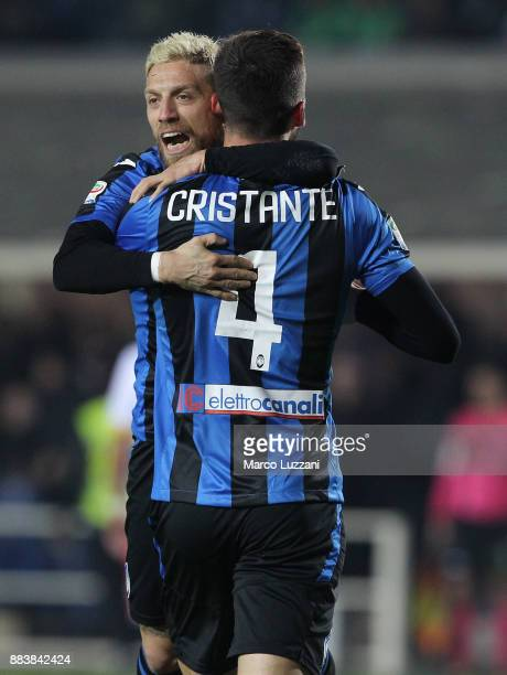 Bryan Cristante of Atalanta BC celebrates with his teammate Alejandro Dario Gomez after scoring the opening goal during the Serie A match between...