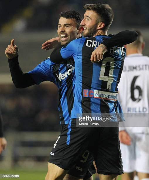 Bryan Cristante of Atalanta BC celebrates with his teammate Andrea Petagna after scoring the opening goal during the Serie A match between Atalanta...