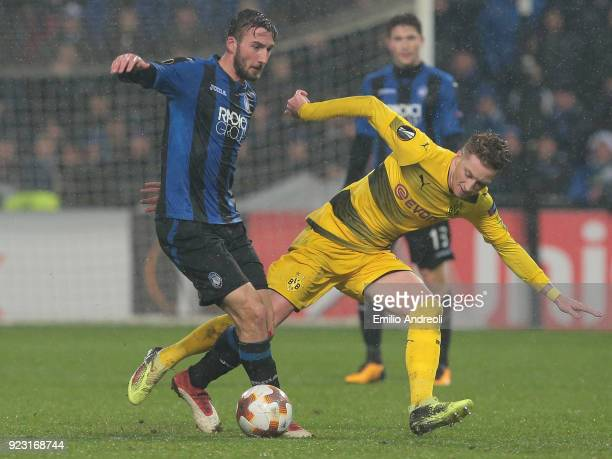 Bryan Cristante of Atalanta BC competes for the ball with Marco Reus of Borussia Dortmund during UEFA Europa League Round of 32 match between...
