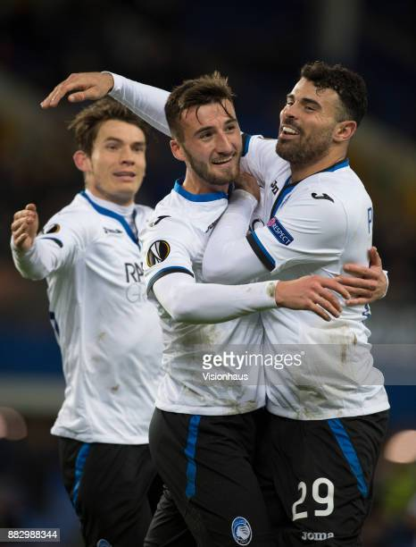 Bryan Cristante of Atalanta BC is congratulated by team mates Marten de Roon and Andrea Petagna after scoring during the UEFA Europa League group E...