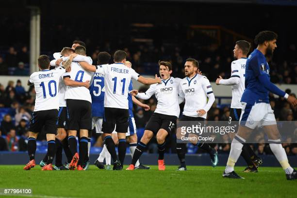 Bryan Cristante of Atalanta celebrates with team mates after scoring his sides first goal during the UEFA Europa League group E match between Everton...