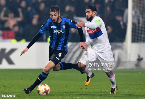 Bryan Cristante of Atalanta competes for the ball whit Nabil Fekir of Olympique Lyon during the UEFA Europa League group E match between Atalanta and...