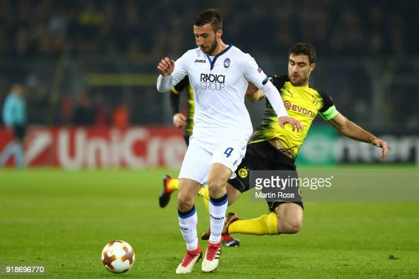 Bryan Cristante of Atalanta is tackled by Sokratis Papastathopoulos of Borussia Dortmund during UEFA Europa League Round of 32 match between Borussia...