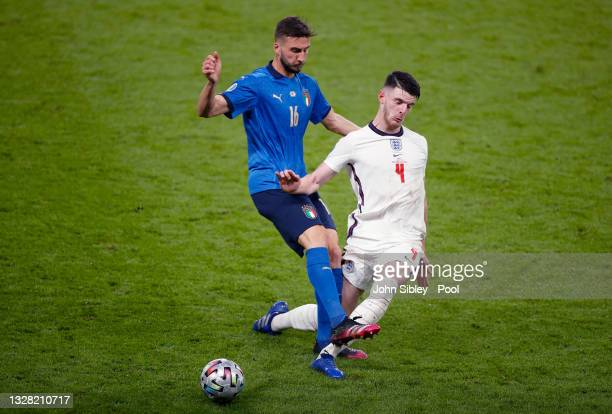 Bryan Cristante of Italy is challenged by Declan Rice of England during the UEFA Euro 2020 Championship Final between Italy and England at Wembley...