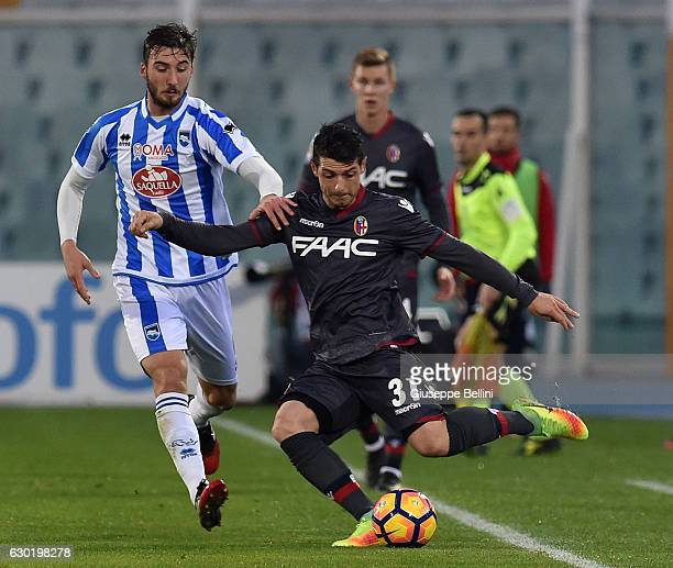 Bryan Cristante of Pescara Calcio and Blerim Dzemaili of Bologna FC in action during the Serie A match between Pescara Calcio and Bologna FC at...