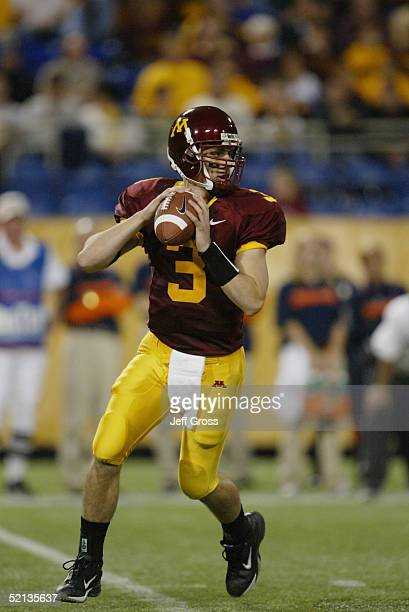 Bryan Cupito of the Minnesota Gophers looks to pass during the game against the Illinois Fighting Illini at the Hubert H Humphrey Metrodome on...