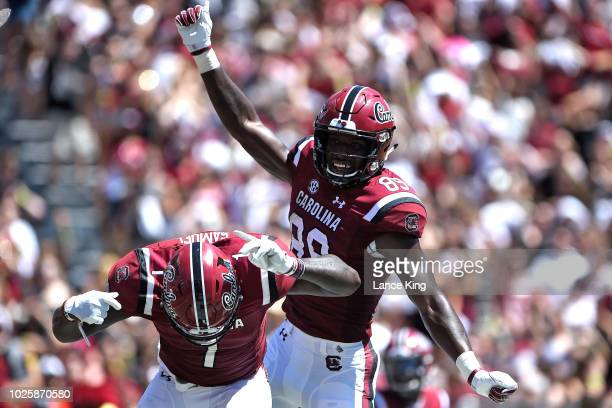 Bryan Edwards and Deebo Samuel of the South Carolina Gamecocks celebrate following a touchdown reception by Edwards during their game against the...