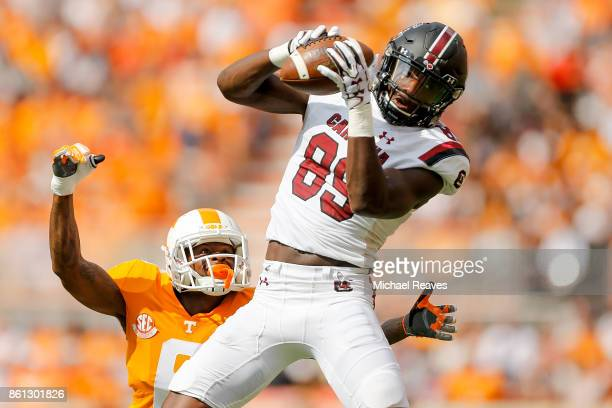 Bryan Edwards of the South Carolina Gamecocks makes a catch defended by Shaq Wiggins of the Tennessee Volunteers during the first half at Neyland...