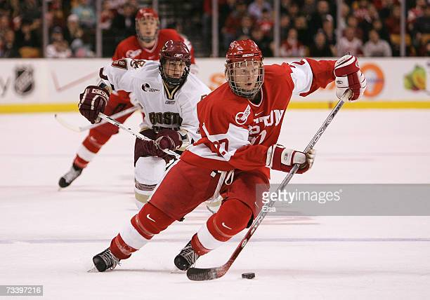 Bryan Ewing of the Boston University Terriers carries the puck into the offensive zone against the Boston College Eagles during the Beanpot...