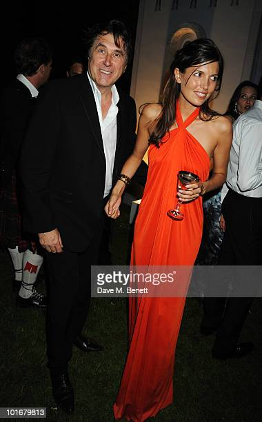 Bryan Ferry and Amanda Sheppard attend the Raisa Gorbachev Foundation Party at Stud House Hampton Court Palace on June 5 2010 in Richmond upon Thames...