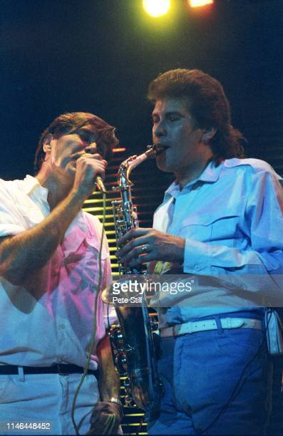 Bryan Ferry and Andy Mackay of Roxy Music perform on stage at Wembley Arena during the 'Flesh Blood' tour on August 2nd 1980 in London England