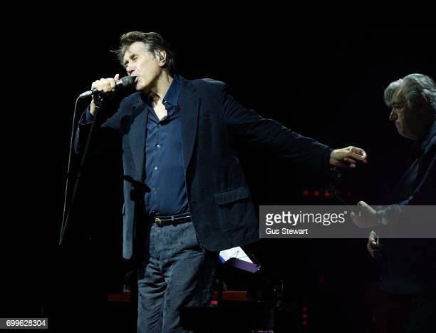 Bryan Ferry and Chris Spedding perform on stage at Hampton Court Palace on June 21 in London England