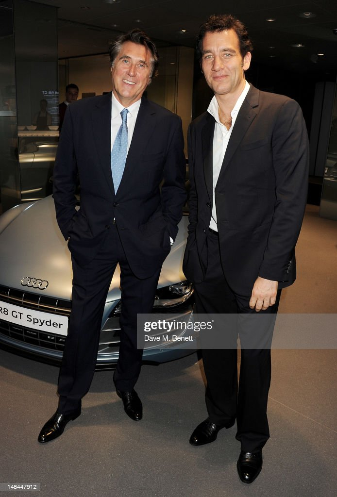 Bryan Ferry (L) and Clive Owen attend a party celebrating the global launch of Audi City, Audi's first digital showroom, featuring an art installation by Chris Cunningham, on July 16, 2012 in London, England.