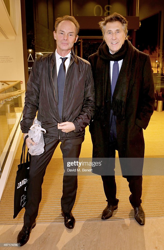 Bryan Ferry (R) and Stellan Holm attend the launch party for Phillips European Headquarters at 30 Berkeley Square on October 13, 2014 in London, England.