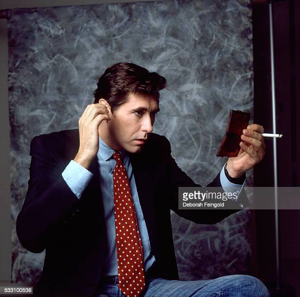 Bryan Ferry Checks Himself Out in Mirror