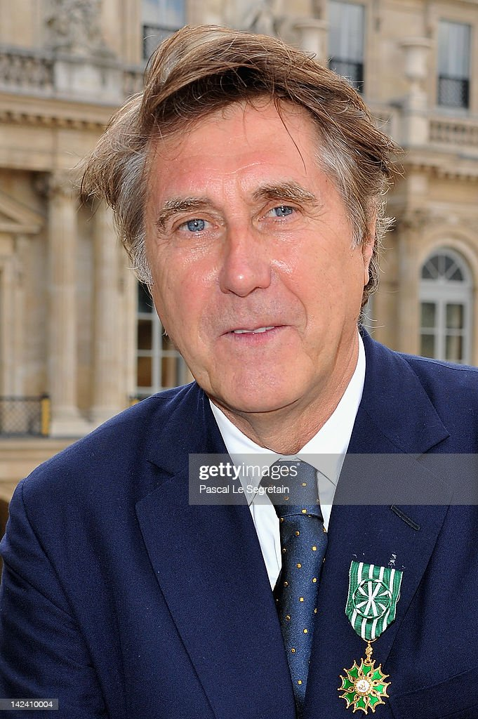 Bryan Ferry poses after being honored by French Ministerat Ministere de la Culture on April 4, 2012 in Paris, France.