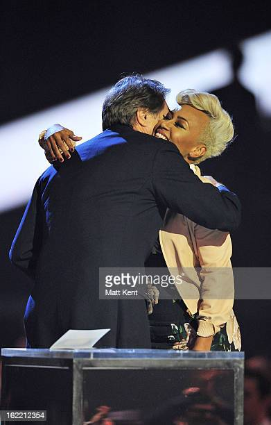Bryan Ferry presents the Mastercard British Album of the Year award to Emeli Sandé on stage during the Brit Awards 2013 at the 02 Arena on February...