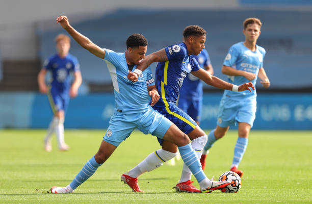 Bryan Fiabema of Chelsea holds off a challenge from Tai Sodje of Manchester City during the Premier League 2 match between Manchester City and...