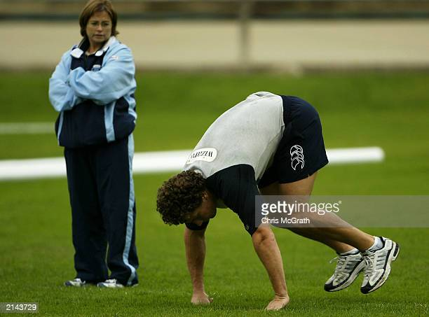 Bryan Fletcher of the Blues goes through a fitness test watched by medical staff during the New South Wales Blues training session held at Wentworth...