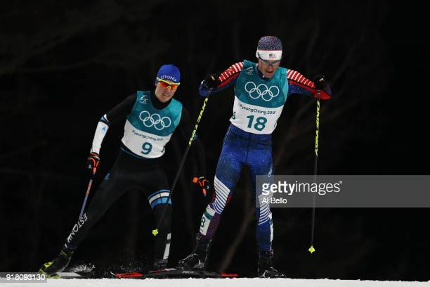 Bryan Fletcher of the United States and Kristjan Ilves of Estonia compete during the Nordic Combined Individual Gundersen Normal Hill and 10km Cross...