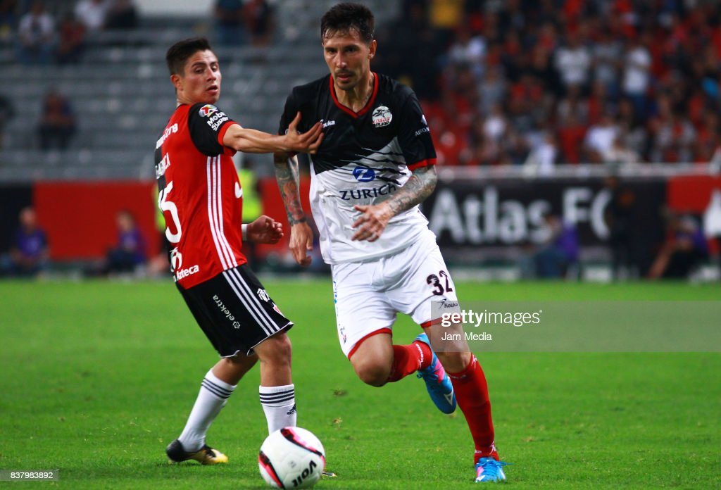 Bryan Garnica (L) of Atlas and Jonathan Fabbro (R) of Lobos BUAP fight for the ball during the 6th round match between Atlas and Lobos BUAP as part of the Torneo Apertura 2017 Liga MX at Jalisco Stadium on August 22, 2017 in Guadalajara, Mexico.