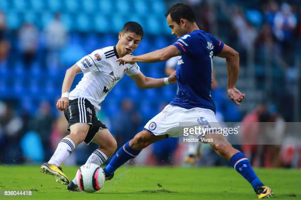 Bryan Garnica of Atlas struggles for the ball with Adrian Aldrete of Cruz Azul during the fifth round match between Cruz Azul and Atlas as part of...