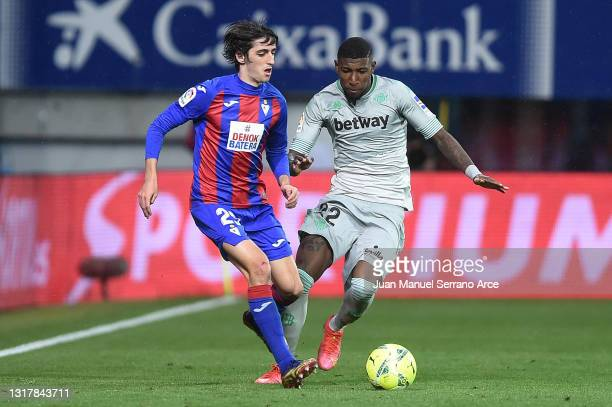 Bryan Gil of Eibar is challenged by Emerson of Real Betis during the La Liga Santander match between SD Eibar and Real Betis at Estadio Municipal de...