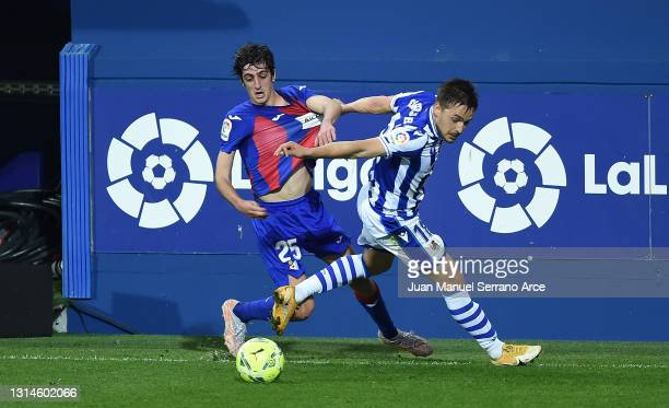 Bryan Gil of SD Eibar battles for possession with Andoni Gorosabel of Real Sociedad during the La Liga Santander match between SD Eibar and Real...