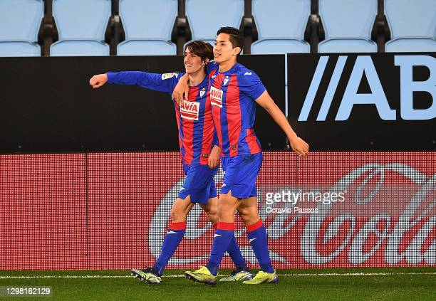 Bryan Gil of SD Eibar celebrates after scoring their sides first goal with team mate Yoshinori Muto during the La Liga Santander match between RC...