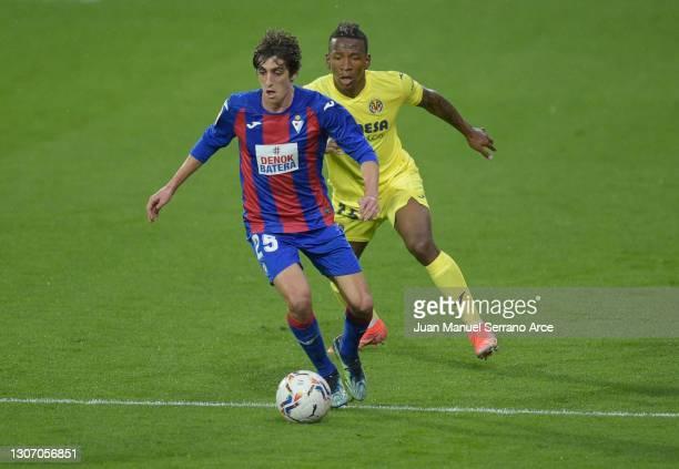 Bryan Gil of SD Eibar is closed down by Pervis Estupinan of Villarreal CF during the La Liga Santander match between SD Eibar and Villarreal CF at...