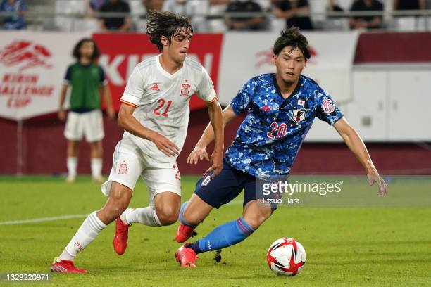 Bryan Gil of Spain and Koki Machida of Japan compete for the ball during the U-24 international friendly match between Japan and Spain at the Noevir...