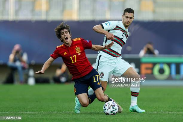 Bryan Gil of Spain fouled by Diogo Dalot of Portugal during the 2021 UEFA European Under-21 Championship Semi-finals match between SF1 and SF2 at...