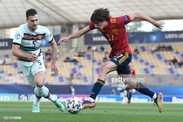 Bryan Gil of Spain is put under pressure by Diogo Dalot of Portugal during the 2021 UEFA European Under-21 Championship Semi-finals match between...