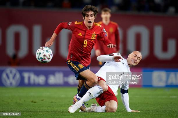 Bryan Gil of Spain is tackled by Jaba Kankava of Georgia during the FIFA World Cup 2022 Qatar qualifying match between Georgia and Spain at Boris...