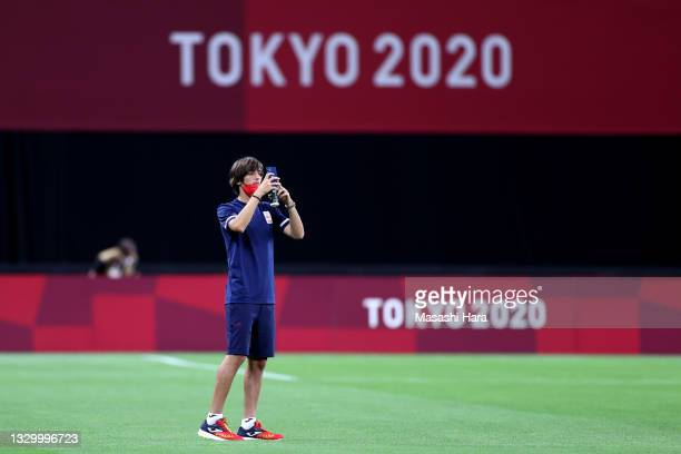 Bryan Gil of Team Spain takes a picture as he inspects the pitch prior to the Men's First Round Group C match between Egypt and Spain during the...