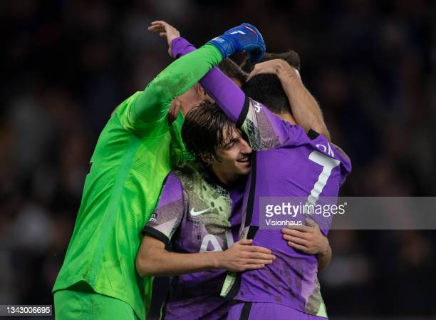 Bryan Gil of Tottenham Hotspur celebrates winning the penalty shoot out with team mates Sergio Reguilón, goalkeeper Pierluigi Gollini and Heung-Min...