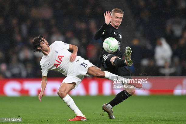 Bryan Gil of Tottenham Hotspur tackles Zan Karnicnik of NS Mura during the UEFA Europa Conference League group G match between Tottenham Hotspur and...