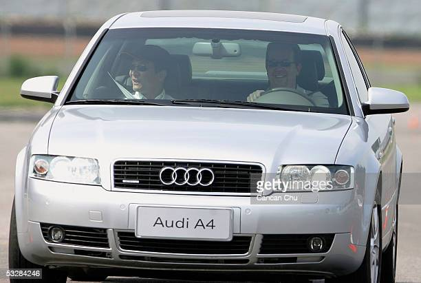 Bryan Glazer son of new Manchester United owner Malcolm Glazer tries an Audi A4 during a business event held by the team's sponsor Audi on July 25...