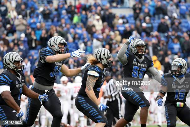 Bryan Goodson, Jackson Dillon, Jonathan Wilson, Bryce Huff and Nehemiah Augustus of the Memphis Tigers celebrate against the Houston Cougars during...