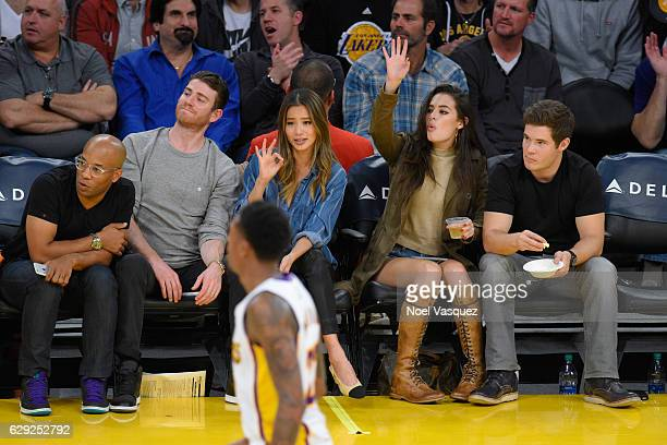 Bryan Greenberg Jamie Chung Chloe Bridges and Adam DeVine attend a basketball game between the New York Knicks and the Los Angeles Lakers at Staples...