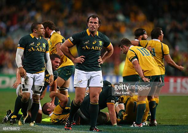 Bryan Habana and Bismarck du Plessis of the Springboks look on dejected as the Wallabies celebrate winning The Rugby Championship match between the...