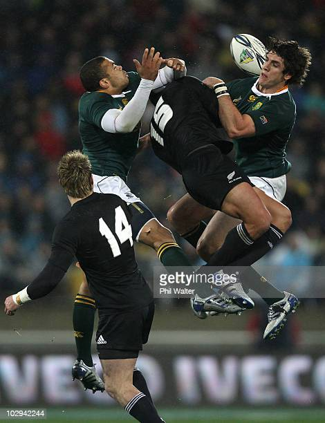 Bryan Habana and Jaque Fourie of the Springboks and Mils Muliaina of the All Blacks compete for the aerial ball during the TriNations match between...