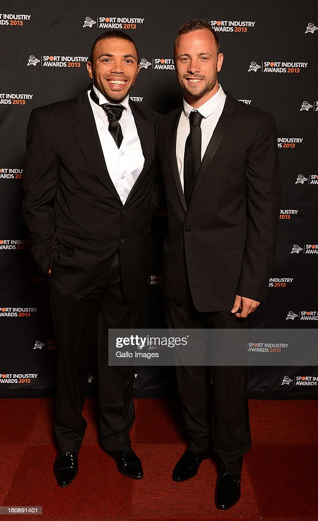 Bryan Habana (L) and Oscar Pistorius attend the Virgin Active Sport Industry Awards 2013 held at Emperors Palace on February 07, 2013 in Johannesburg, South Africa.