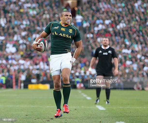 Bryan Habana grimaces after pulling a hamstring during the Rugby Championship match between South Africa Springboks and the New Zealand All Blacks at...