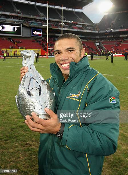 Bryan Habana holds the trophy after their series win during the Third Test match between South African and the British and Irish Lions at Ellis Park...