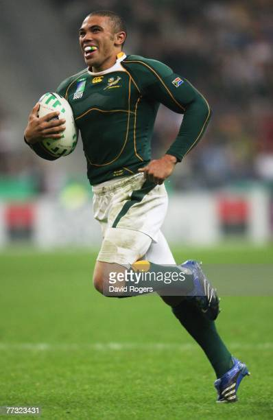 Bryan Habana of South Africa breaks clear to score his team's fourth try during the Rugby Word Cup Semi Final between South Africa and Argentina at...