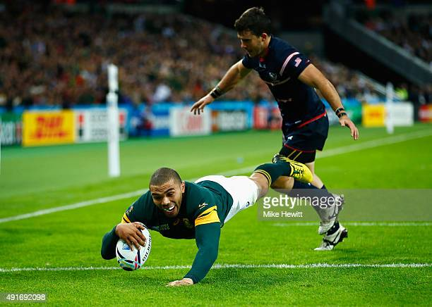 Bryan Habana of South Africa goes over to score his hat trick try and South Africa's seventh during the 2015 Rugby World Cup Pool B match between...
